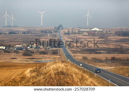 Wind power stations in Lithuania at sunset time - stock photo