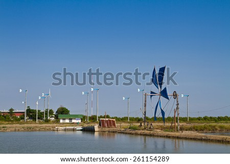 Wind power tool for bringing water into the salt farm - stock photo