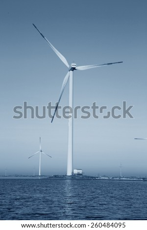 Wind power under the blue sky - stock photo