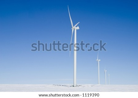 Wind powered turbines generate electricity and improve our environment. - stock photo