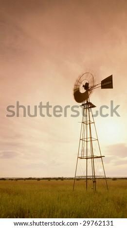 Wind Pump spinning - stock photo