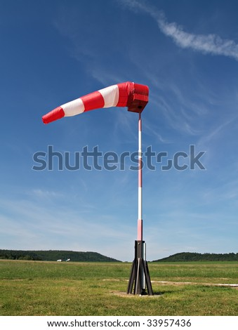 wind sock at small airfield - stock photo