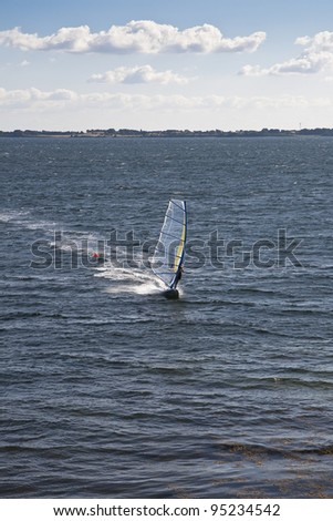 Wind surfer approaching the coast. Copy Space