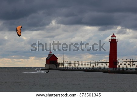 Wind Surfer in Grand Haven Lighthouse in Michigan. - stock photo