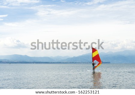 wind surfer on lake Garda in Italy - stock photo