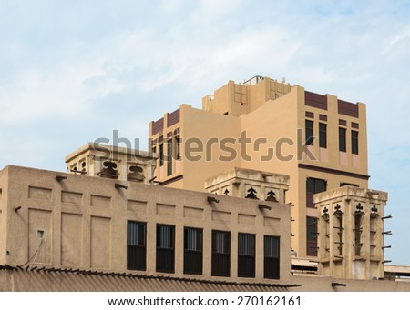 Wind tower, Arabian architecture, Bastakiya, Dubai, UAE. Wind towers are used in the United Arab Emirates to cool their buildings. - stock photo