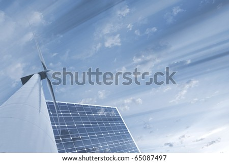 wind turbie and solar panel with dynamic sky background - stock photo