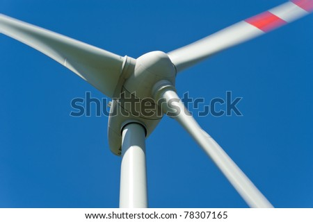 Wind turbine against a blue background - stock photo