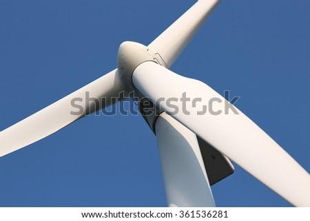 wind turbine against blue sky - stock photo