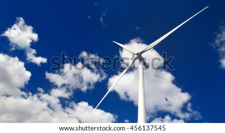 wind turbine against blue sky - stock photo