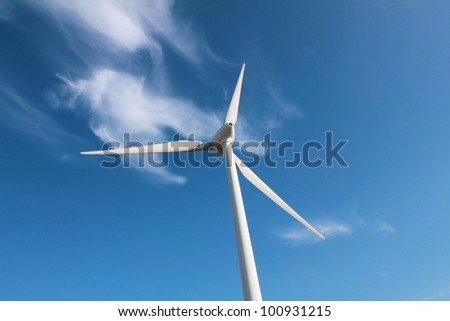 Wind turbine against cloud - stock photo