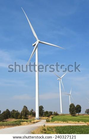 wind turbine against cloudy blue sky background  - stock photo