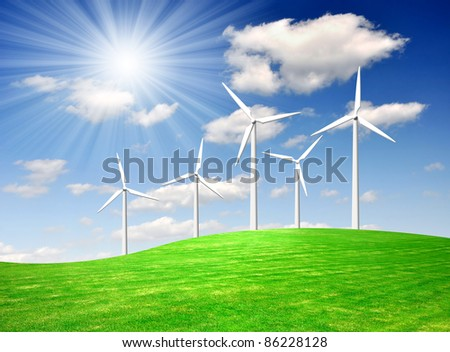 wind turbine against the blue sky - stock photo