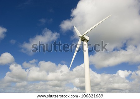 Wind turbine against the cloudy sky.This is in Cornwall (UK). - stock photo
