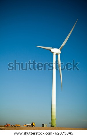 Wind Turbine - alternative and green energy source construction site - stock photo