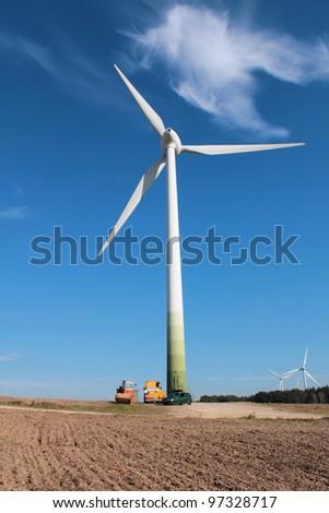 Wind turbine and a cloud - stock photo