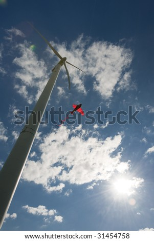 Wind turbine and kite - stock photo
