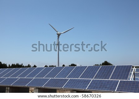 Wind turbine and photovoltaic panels for clean energy - stock photo