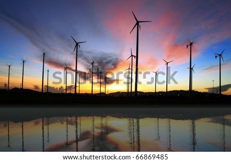 wind turbine and reflection - stock photo