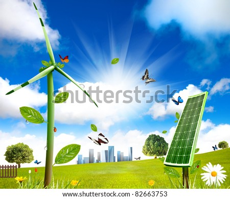 Wind turbine and solar cell grows in the field - stock photo