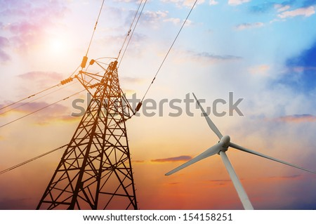 Wind turbine and the High-voltage tower - stock photo