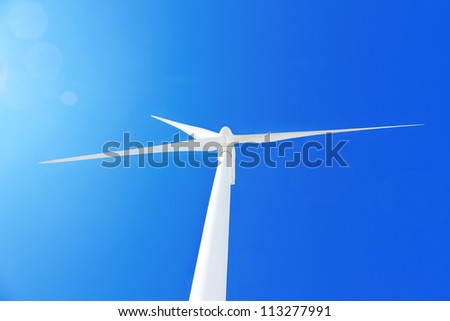 Wind turbine  at blue sky. - stock photo