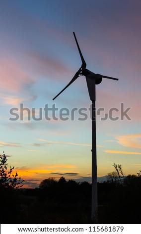 wind turbine at sunset. - stock photo