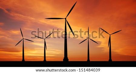 wind turbine at sunset background ecosystem for design - stock photo