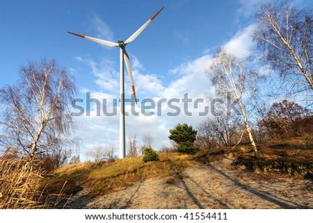 Wind turbine - Autumn scenery - stock photo