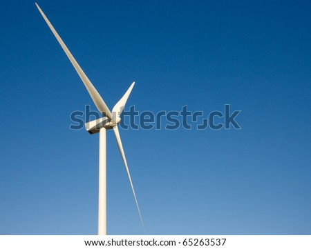 Wind turbine blades against blue sky. Peterborough England - stock photo