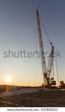 Wind turbine construction crane - stock photo