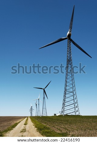 Wind turbine electric generator farm in early spring - an alternative renewable energy resource