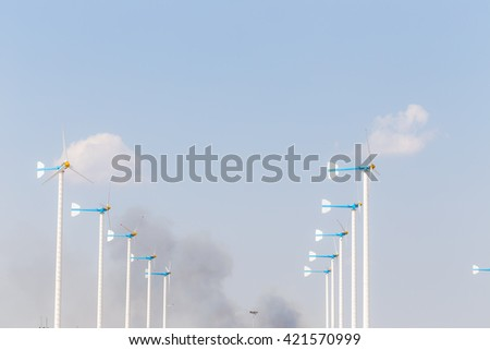 Wind Turbine energy in rural farm, Eco power - stock photo
