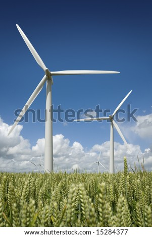 Wind turbine farm against a summer blue sky. - stock photo