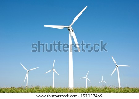 Wind turbine farm and blue sky background