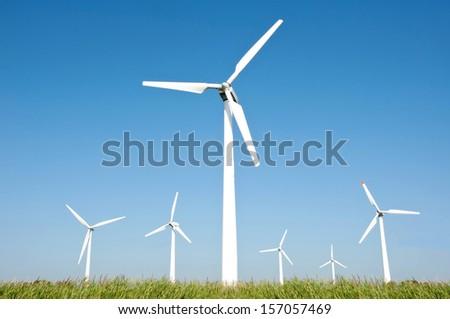 Wind turbine farm and blue sky background  - stock photo