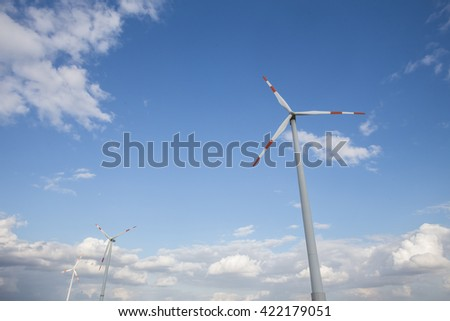 wind turbine farm cloudscape - stock photo