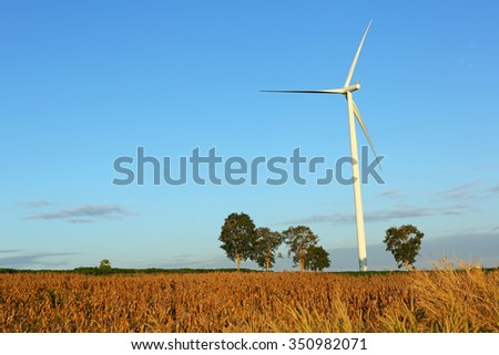Wind turbine farm, generating electricity with blue sky background in Thailand