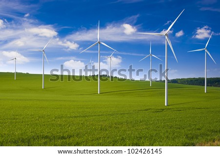 Wind turbine farm in the field - a renewable energy source - stock photo