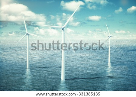 Wind turbine farm in the ocean - stock photo