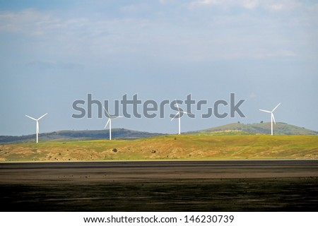 Wind turbine farm on a hillside in Australia