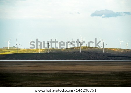 Wind turbine farm on a hillside in Australia - stock photo