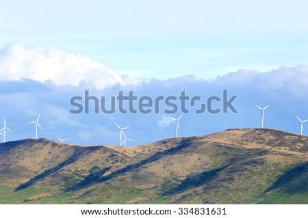 Wind turbine farm on the hill, South Island, New Zealand  - stock photo