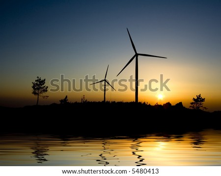 Wind turbine farm over sunset - water reflection