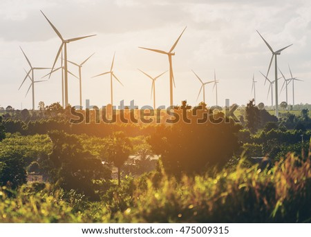 Wind turbine farm; renewable energy, sustainable energy and alternative energy. Silhouette image of wind turbine farm. Environment friendly and wind energy concept. Sustainability of energy concept.