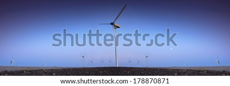 Wind turbine farm with blue sky in the evening - stock photo