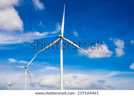 wind turbine for generate electricity with blue sky, renewable energy