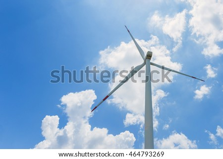 Wind turbine for sustainable energy and environmentally friendly, blue sky and clouds background