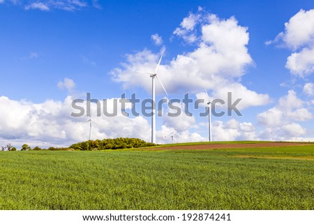 wind turbine generating electricity with blue clouds sky