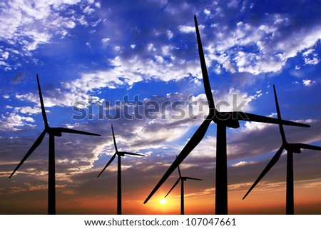 wind turbine generator with sunset on background - stock photo